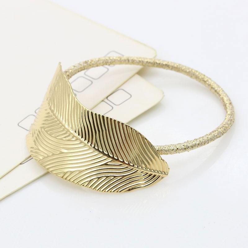 Kovová spona do vlasů - pírko - zlatá barva